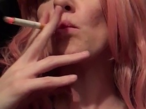 Sexy Redhead smokes and rubs shaven pussy