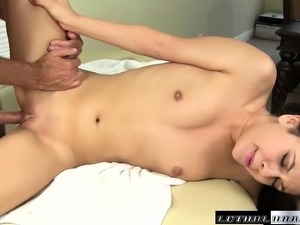 Pigtailed cutie Lucy Doll relishes a deep fucking on the massage bed