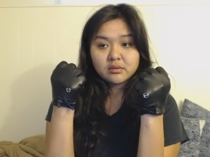 dee tries on leather gloves
