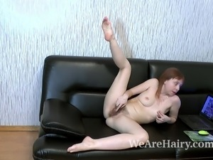 Trixie strips and masturbates on her black couch