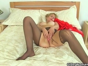 UK milfs Ila Jane and Lelani rip holes in their nylon tights and rub their...