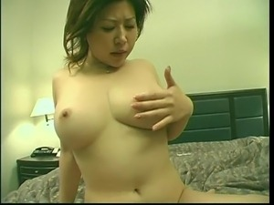 Busty asian nympho rides a fat cock in bed