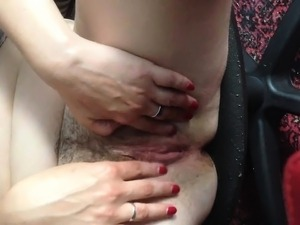 Insatiable mature woman uses her fingers and a dildo to please herself