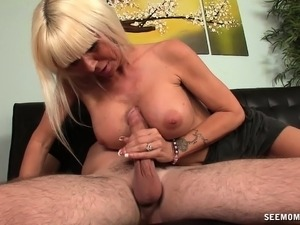 Lucky young guy has a busty blonde cougar working her lips on his dick