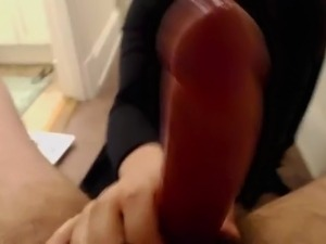 Pretty brunette girl gives a blowjob to a chubby guy