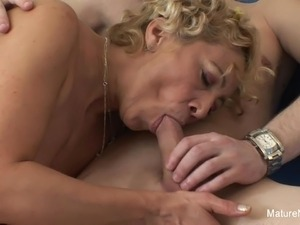 Blonde mature fucks him 'til he cums on her tits